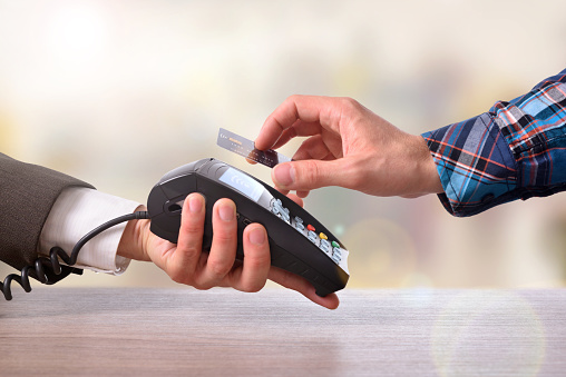 istock Customer paying a merchant with contactless card front view 539658834