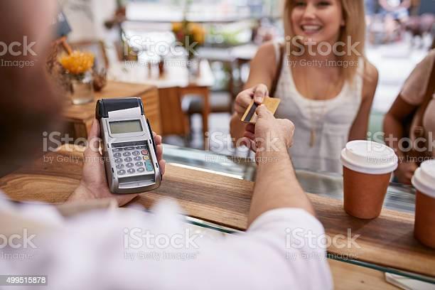 Customer paying at a cafe with credit card picture id499515878?b=1&k=6&m=499515878&s=612x612&h=x2iawqx9tw5uvvkaln rafy3wncqimfbcq8vx qskjc=