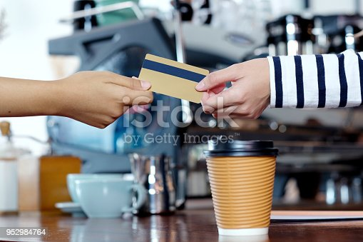 istock Customer paying coffee by credit, debit electronic card at cafe counter, food and drink business concept 952984764
