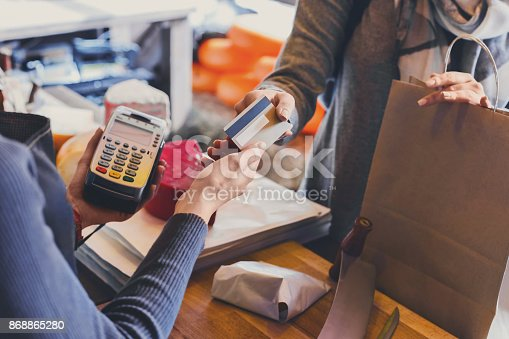 istock Customer paying for order of cheese in grocery shop. 868865280