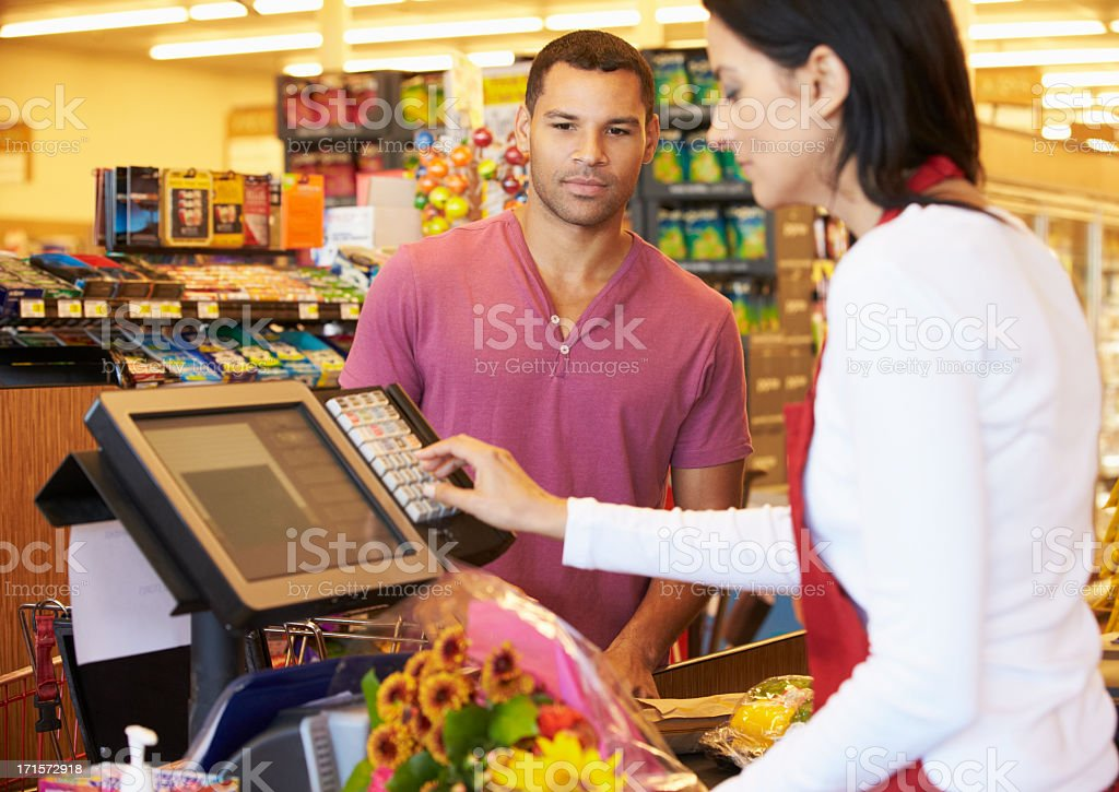 Customer Paying For Shopping stock photo