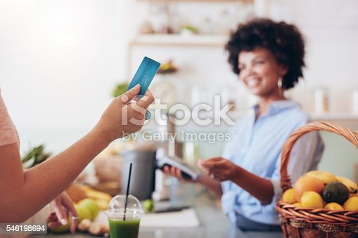 istock Customer paying for their order with a credit card 546198694