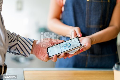 178974134 istock photo Customer paying using contactless payment option in a cafe 1132067077