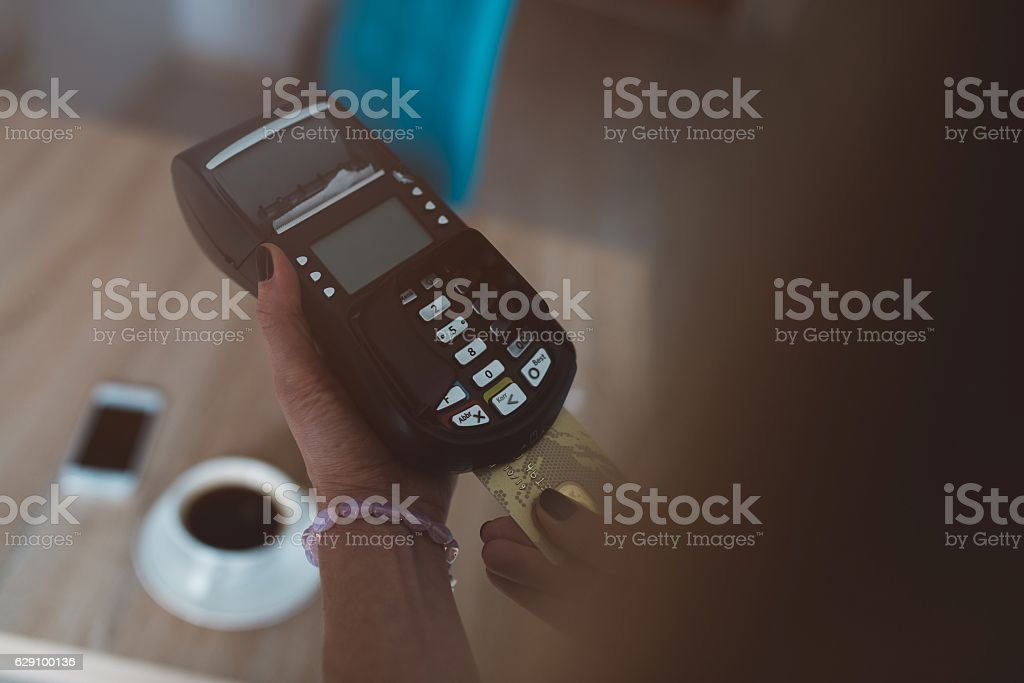Customer pays by credit card stock photo
