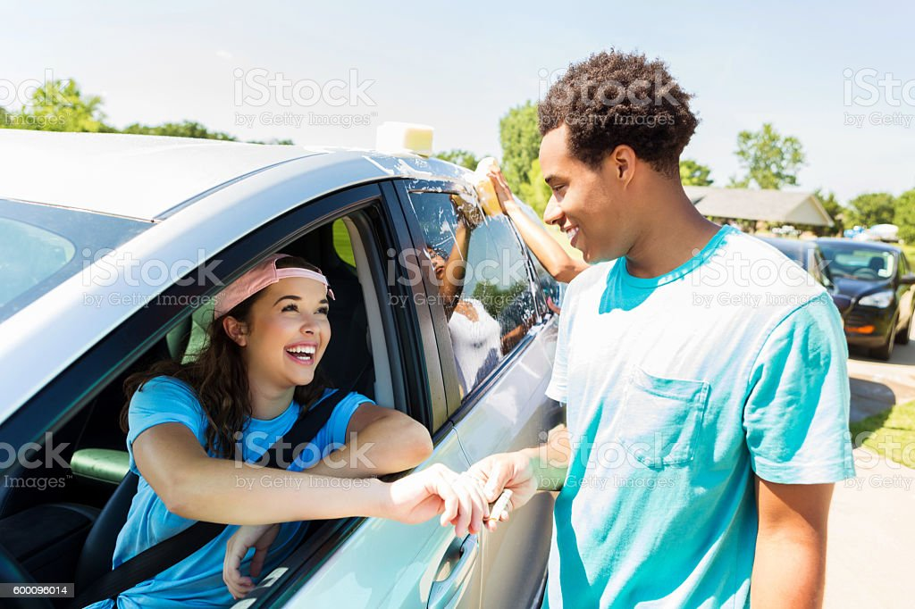 Customer pays to have car wash at charity event stock photo