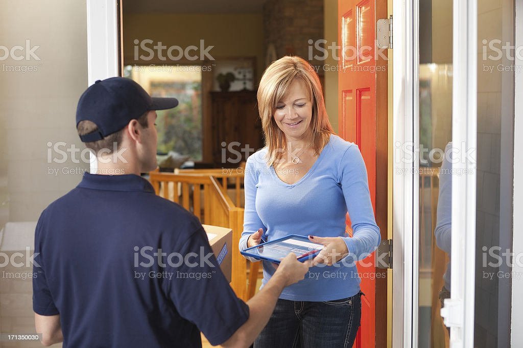 Customer Receiving Package from Home Delivery Service Hz royalty-free stock photo