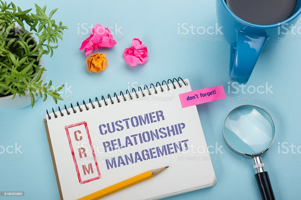 CRM customer relation management Text written on notebook page, pen stock photo
