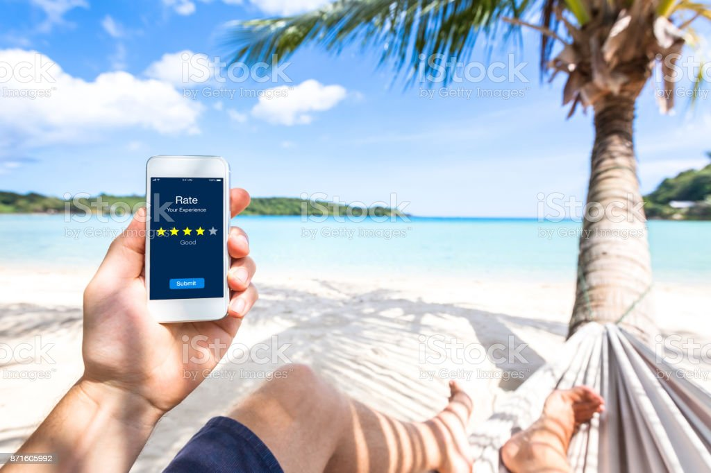 Customer review on smartphone screen, rate experience, feedback, stars, beach - Royalty-free Advice Stock Photo
