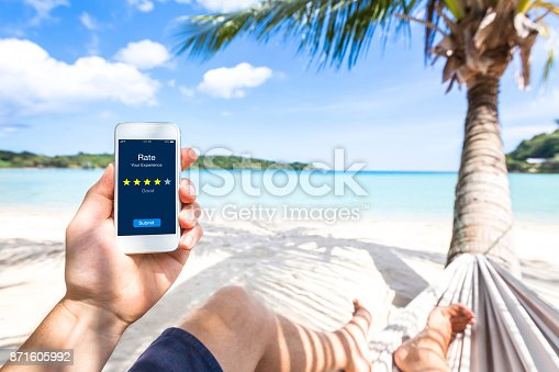istock Customer review on smartphone screen, rate experience, feedback, stars, beach 871605992