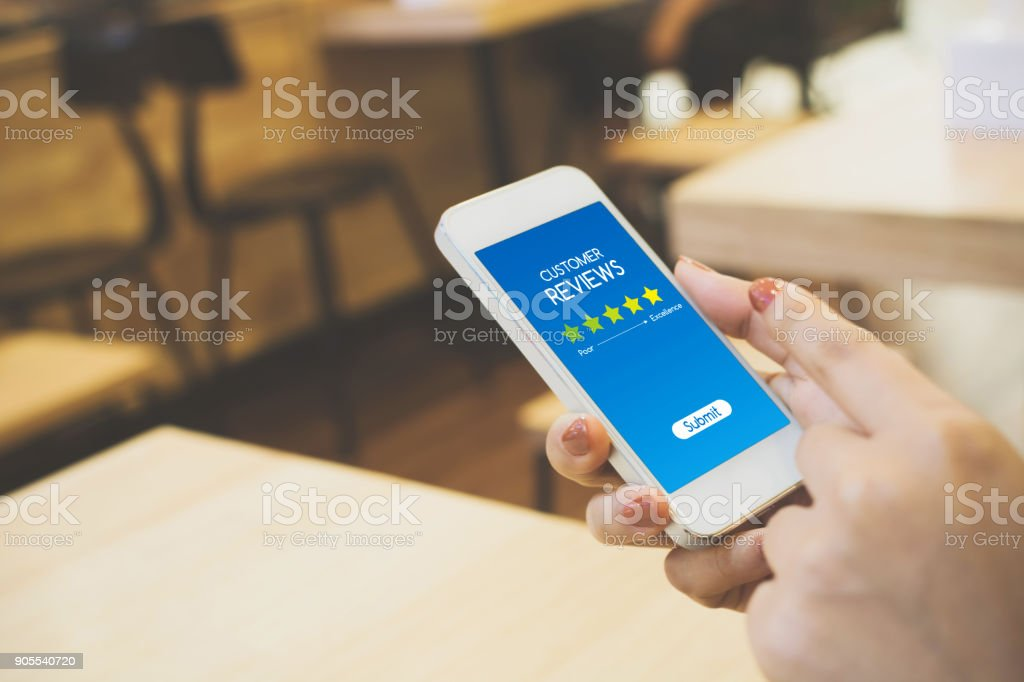 Customer review rating business concept, Woman hand using mobile phone stock photo