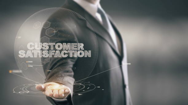 Client Satisfaction homme tenant en main nouvelles technologies - Photo