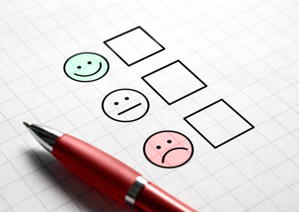 Customer satisfaction survey and questionnaire concept. Giving feedback with multiple choice form. stock photo
