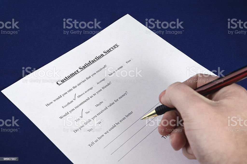 Customer satisfaction survey being completed. royalty-free stock photo