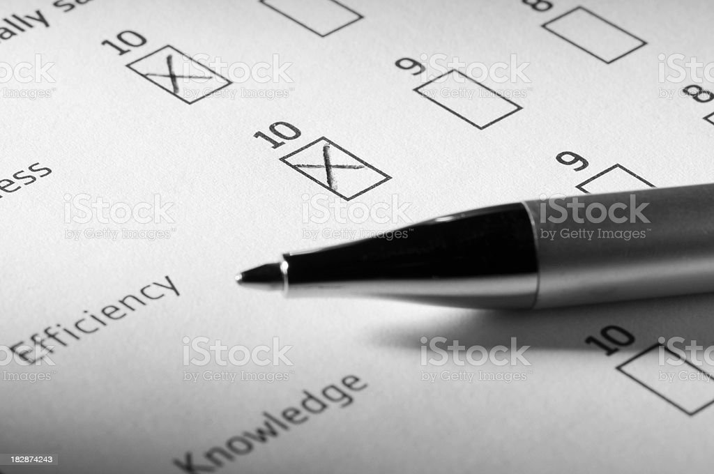 Customer satisfaction survey partially completed with pen royalty-free stock photo
