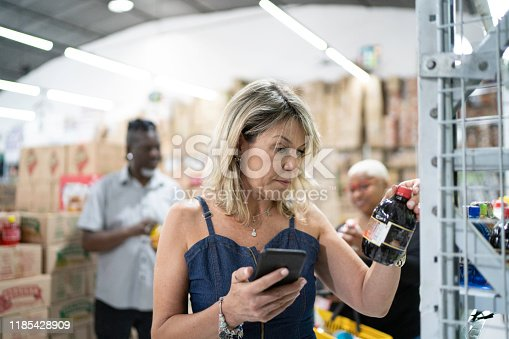 1184048369 istock photo Customer scanning a product at wholesale 1185428909