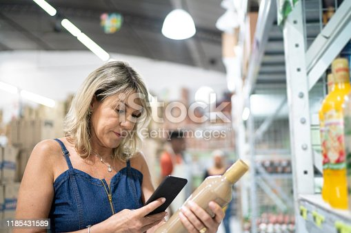 1184048369 istock photo Customer scanning a product at wholesale 1185431589