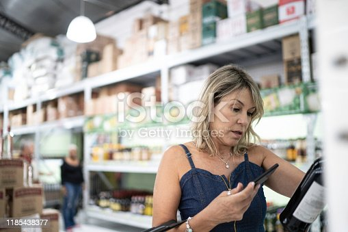 1184048369 istock photo Customer scanning a product at wholesale 1185438377