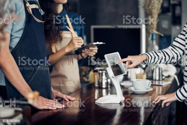 Customer self service order drink menu with tablet screen at cafe picture id979180054?b=1&k=6&m=979180054&s=612x612&h=okpzp5irok3dy0zlqqjrskejbin  vrnxqvfasyojkk=