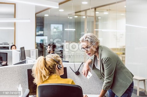 1090214584 istock photo Customer Service Agents Working In Office 1161741072