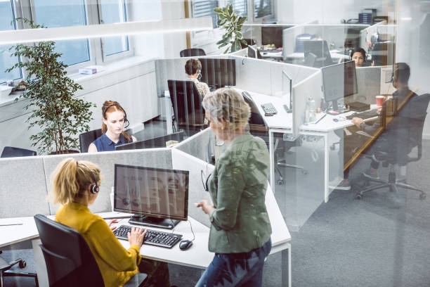 Customer Service Agents Working In Office stock photo