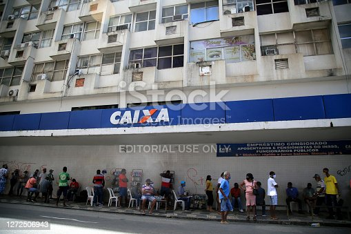 salvador, bahia / brazil - september 8, 2020: people face queues for assistance at Caixa Economica Federal in the neighborhood of Comercio, in the city of Salvador.