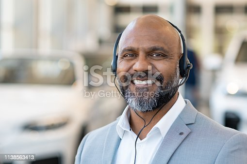 136591850 istock photo Customer service at car dealership 1138563413