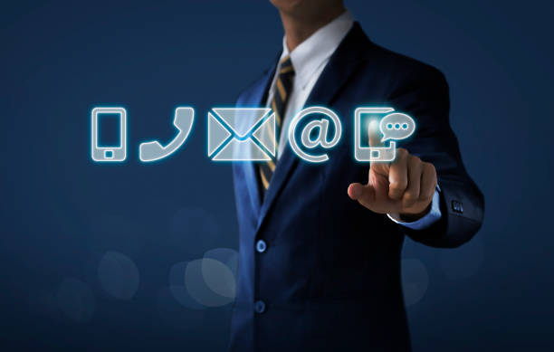 customer service, call center service or contact us concept businessman touching communication icons (mobile phone, telephone, mail, email address, social media) on dark tone background. - feedback icon imagens e fotografias de stock