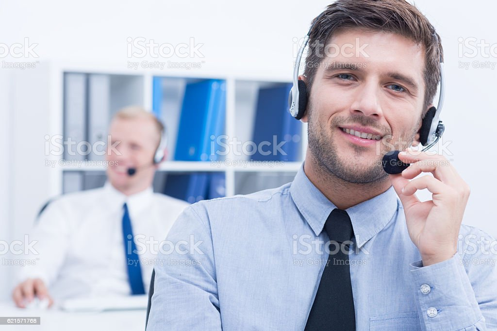 Customer service consultant wearing headset photo libre de droits