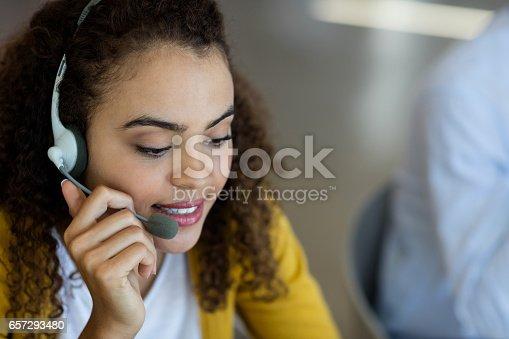 istock Customer service executive talking on headset 657293480