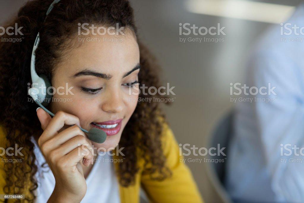 Customer service executive talking on headset stock photo