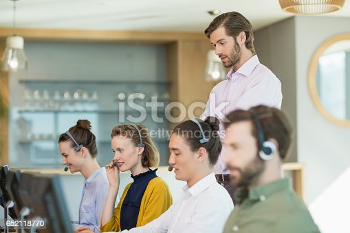 istock Customer service executives working in call center 652118770