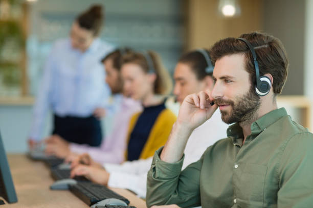 customer service executives working in call center - call center stock photos and pictures