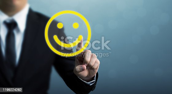 533983044istockphoto Customer service experience and business satisfaction survey. Businessman hand drawing smiley face 1199224262