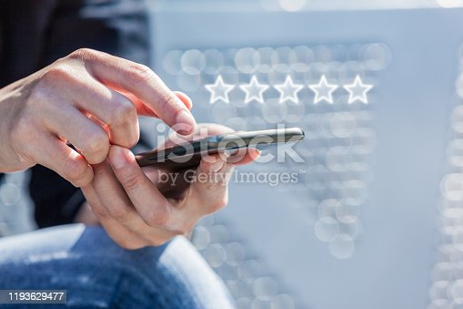 Customer Service Experience Performance Analysis. Close-up of Woman's Hand Holding a Smart Phone with Icon Five Star Symbol to Increase Rating of Company.