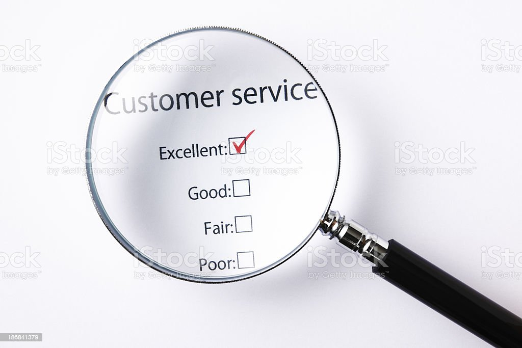 Customer Service Feedback Form and Magnifying Glass royalty-free stock photo
