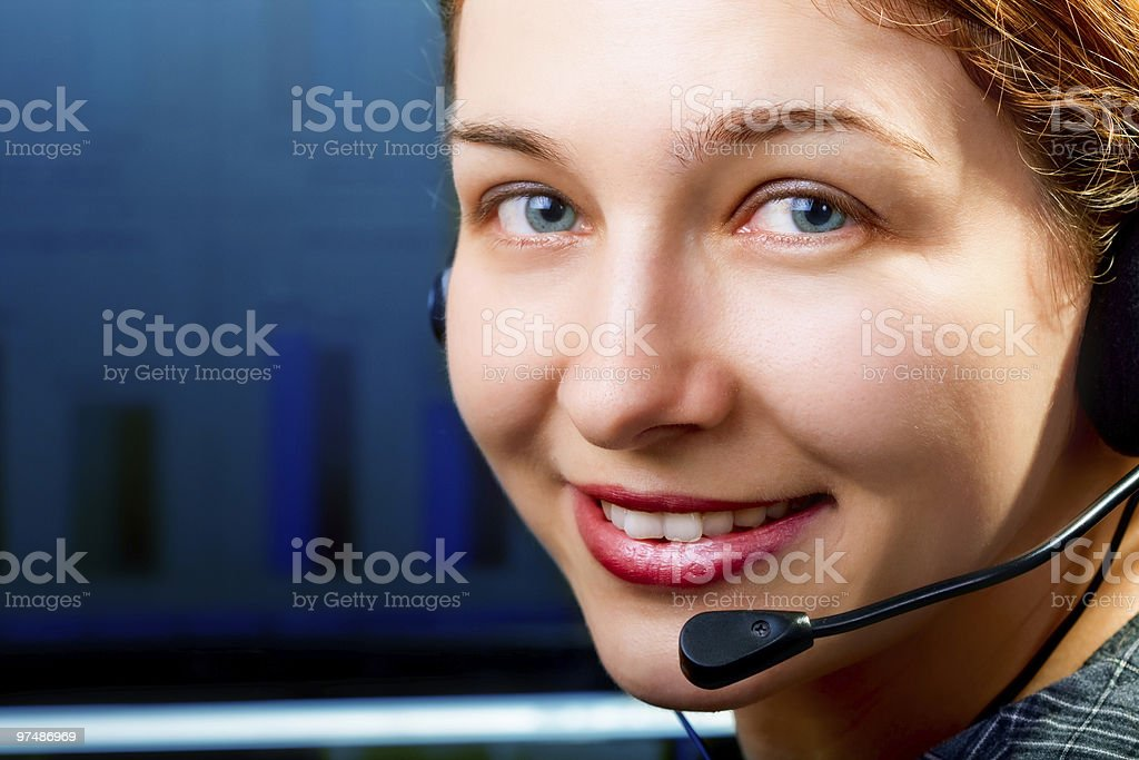 Customer service - friendly cute woman with headphones royalty-free stock photo