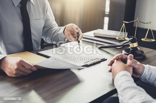 941906652istockphoto Customer service good cooperation, Consultation between a Businessman and Male lawyer or judge consult having team meeting with client, Law and Legal services concept 1000686732