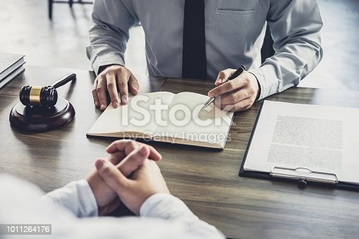 941906652 istock photo Customer service good cooperation, Consultation between a Businessman and Male lawyer or judge consult having team meeting with client, Law and Legal services concept 1011264176