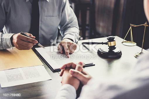 941906652 istock photo Customer service good cooperation, Consultation between a Businessman and Male lawyer or judge consult having team meeting with client, Law and Legal services concept 1021759480