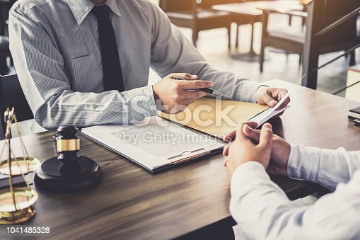 941906652 istock photo Customer service good cooperation, Consultation between a Businessman and Male lawyer or judge consult having team meeting with client, Law and Legal services concept 1041485328