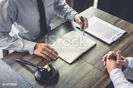 941906652 istock photo Customer service good cooperation, Consultation between a Businessman and Male lawyer or judge consult having team meeting with client, Law and Legal services concept 941073358