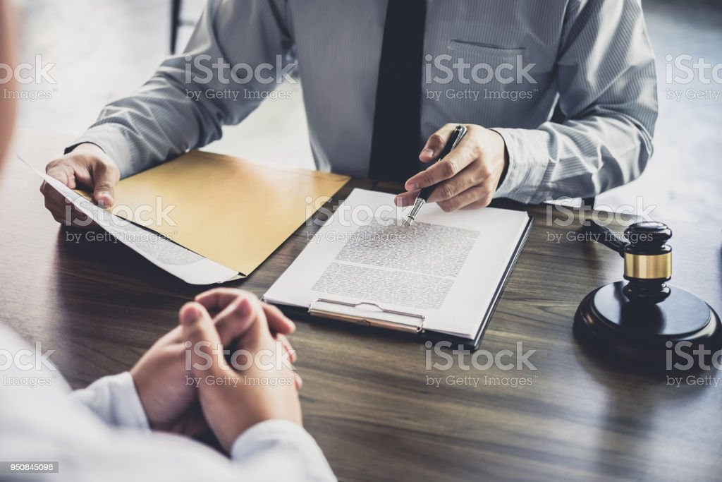 Customer service good cooperation, Consultation between a Businessman and Male lawyer or judge consult having team meeting with client, Law and Legal services concept Customer service good cooperation, Consultation between a Businessman and Male lawyer or judge consult having team meeting with client, Law and Legal services concept. Adult Stock Photo