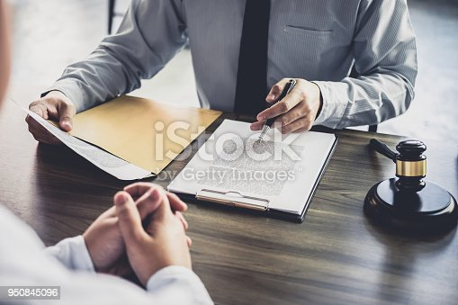istock Customer service good cooperation, Consultation between a Businessman and Male lawyer or judge consult having team meeting with client, Law and Legal services concept 950845096