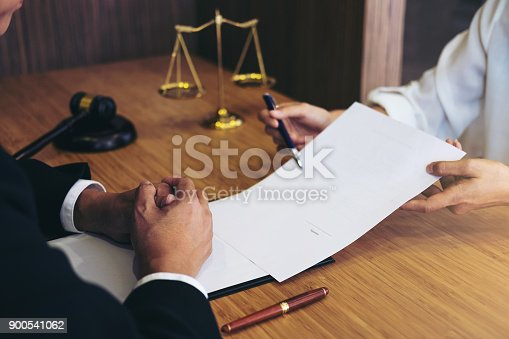 istock Customer service good cooperation, Consultation between a male lawyer and business people customer, tax and the company of real estate concept 900541062
