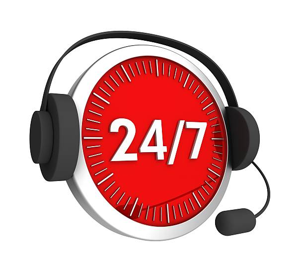 Customer service headset on a red-faced clock with 24/7 stock photo