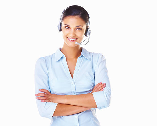 A customer service operative wearing a white headset Portrait of customer service female operator on call on white background hands free device stock pictures, royalty-free photos & images