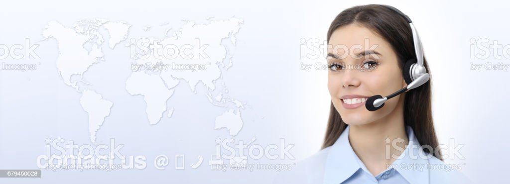 Customer service operator woman with headset smiling, world map on background, contact us concept royalty-free stock photo