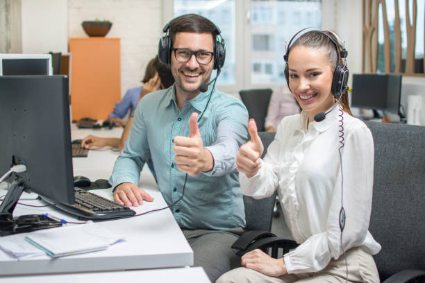 Customer service operators showing thumbs up stock photo