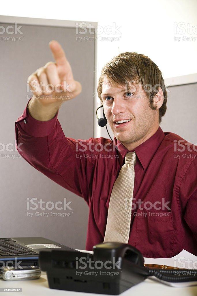 Representante de Servicio al cliente-señalando foto de stock libre de derechos