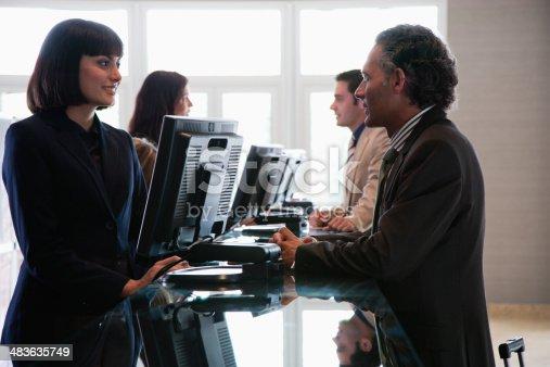 istock Customer service representative helping businessman 483635749